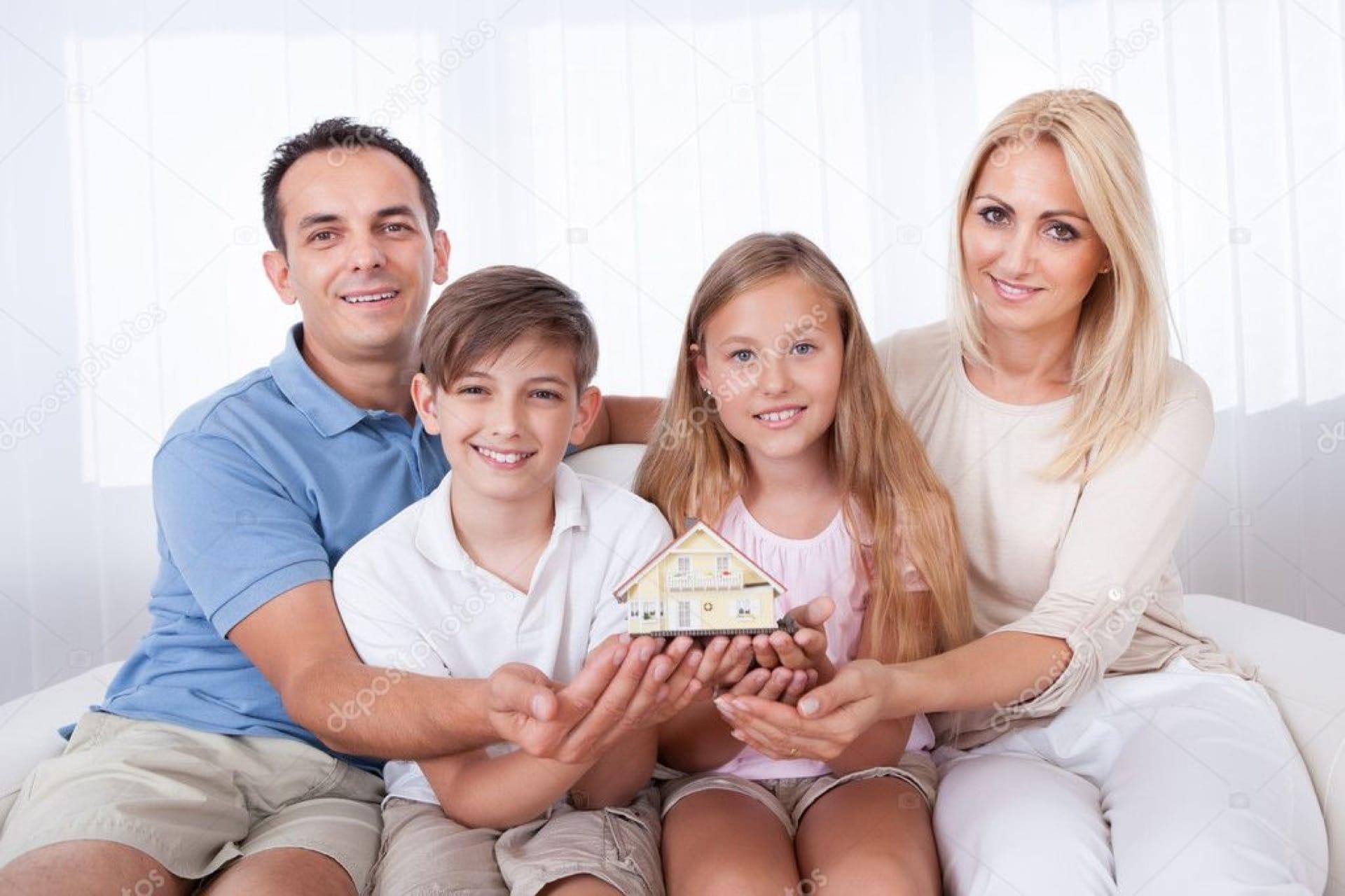 depositphotos_13470361-stock-photo-family-sitting-holding-miniature-model